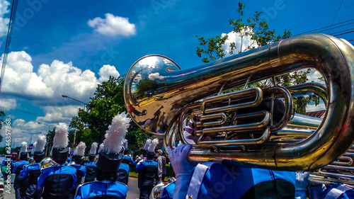 Leinwand Poster Band Playing Tuba During Parade On Street