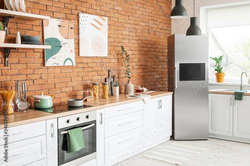 Stylish interior of modern kitchen with big refrigerator Canvas Print