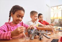 Multiracial Kids Using Building Kit.