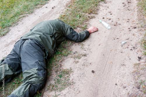 Valokuvatapetti a drunken traveller lying on a forest road