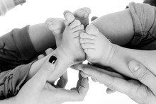 Cropped Image Of Parents Holding Babies Against White Background
