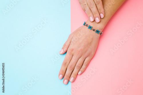 Obraz na płótnie Flower bracelet on young woman hand wrist