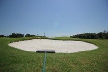Sand Trap At Golf Course Against Sky