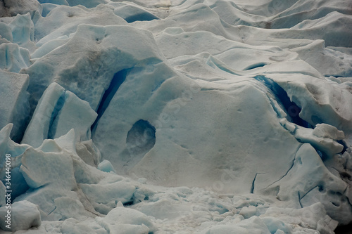 Blue crevasses and seracs on Nigardsbreen glacier in Norway Canvas Print