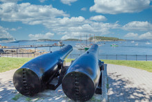 Two Cannons Aimed At Sailboats...