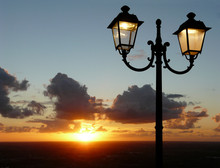 Sunset With Lit Street Lamp