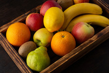 Set Of Fresh Fruits In A Wooden Box On A Dark Background.