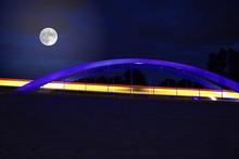 Full Moon Over Bridge At Night