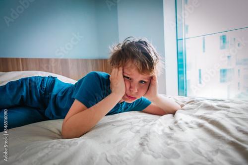 Fototapeta boy feeling anxiety and stress, kid staying home obraz