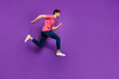 Full body profile side photo of cheerful energetic crazy guy jump run after incredible season spring discount wear lifestyle outfit sneakers isolated over shine color background