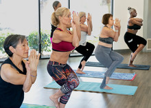 Women In Yoga Class Doing Eagl...