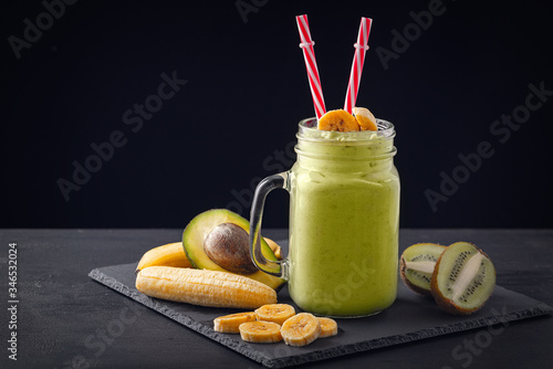 Fresh blended Banana, kiwi and avocado smoothie with yogurt or milk in mason jar, healthy eating Canvas Print