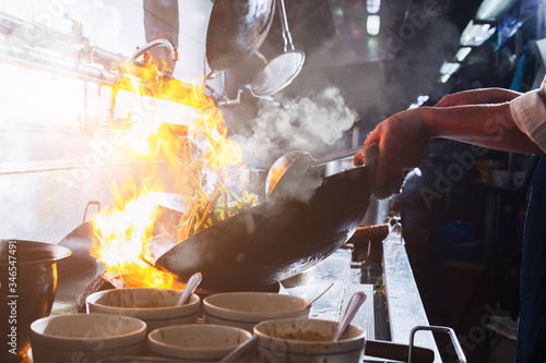 Chef stir fry cooking Canvas Print