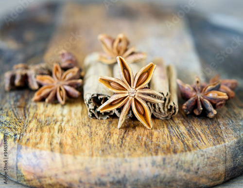 Photo Star anise condiment on the wooden background closeup, macro
