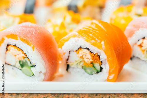 Fototapeta Selective focus point on sushi roll and maki - Japanese food style obraz