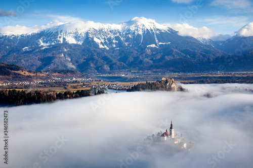 amazing panorama of Lake Bled Blejsko Jezero on a foggy morning with the Pilgrim Canvas Print