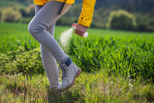 Woman Hiker Spraying Insect Re...