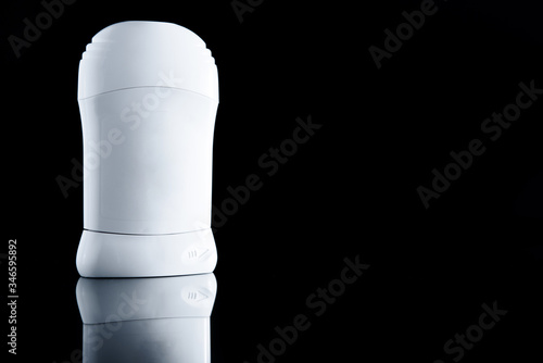 Photo White antiperspirant deodorant standing on black background