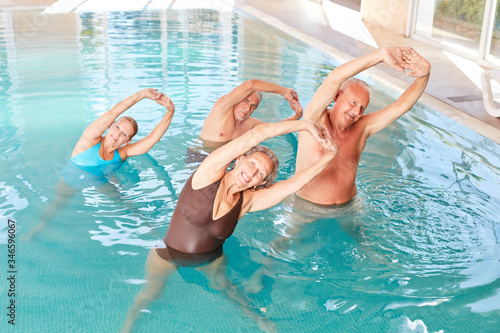 Fototapeta Group seniors in the aqua fitness course obraz
