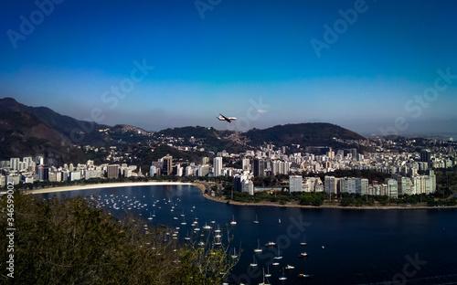 Photo View of Rio de Janeiro with plane overflight, Sugarloaf cable car, Rio de Janeir