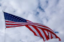 Pole Tied Americcan Blue Red And White Flag Blowing In Tthe Wind