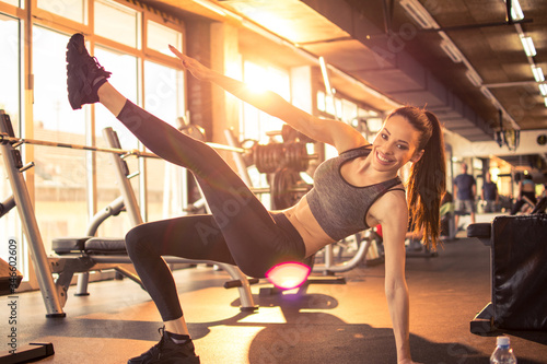 Active sporty girl stretching in the gym Canvas Print