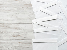 White Envelopes Are Laid Out O...