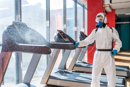 professional disinfector personal protective equipment ppe suit, gloves, mask, c Canvas Print