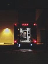Illuminated Red Light Of Ambulance Against Building