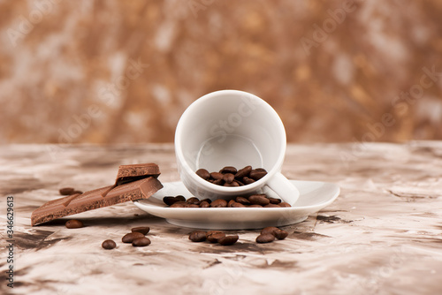 Fototapeta Coffee beans in a coffee cup and saucer. obraz