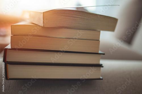Slika na platnu Stack of books on light background