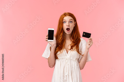 Fototapeta Curious and impressed redhead european woman telling about amazing promotion, sp
