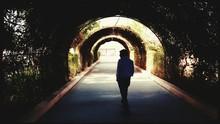 Rear View Of Man Walking In Co...