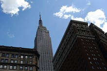 Exterior Of Building With Empire State Building Against Sky