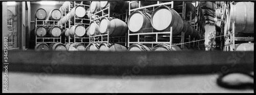 Photo Panoramic Shot Of Wine Barrels In Cellar