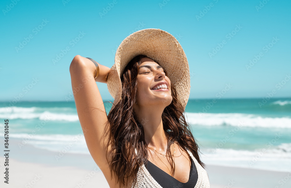 Fototapeta Stylish casual woman enjoying sun at tropical beach