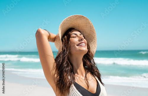 Obraz Stylish casual woman enjoying sun at tropical beach - fototapety do salonu