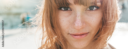 Portrait close up of a beautiful caucasian woman outdoor