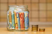 Euro Banknotes In A Glass Jar,...