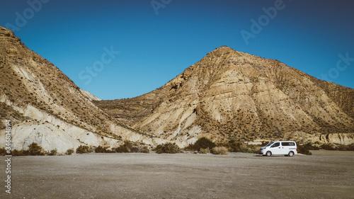 Furgoneta camper aparcada en el desierto de Tabernas en Almeria Canvas Print