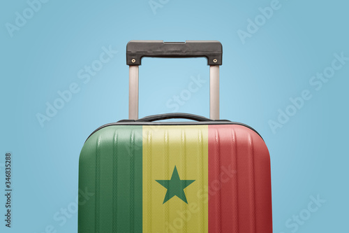 Photo Baggage with Senegal flag print tourism and vacation concept.