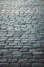 Paving Stones In Perspective. Stone Road. Pavement. Stones In The Form Of Bars For Paving Streets.