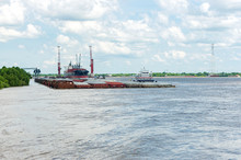 Cargo Carrier And Barges At New Orleans Terminal