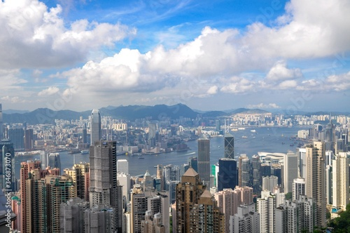Fotografie, Obraz Beautiful view of Hong Kong under a blue cloudy sky and sunlight at daytime in C