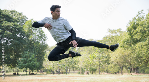 Young handsome sport man jumping training outdoors healthy lifestyle and sport concept Canvas Print