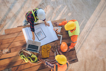 Team Of Engineer And Architects Working, Meeting, Discussing,designing, Planning, Measuring Layout Of Building Blueprints At Construction Site,Top View,Construction Concept.