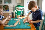 Smiling boy making a cardboard dinosaur costume