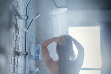 Asian Woman Taking A Shower Wi...