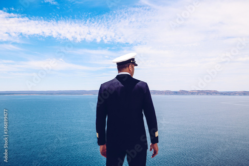 Vászonkép Strong posture of a captain looking at the sea and faraway land on the horizon