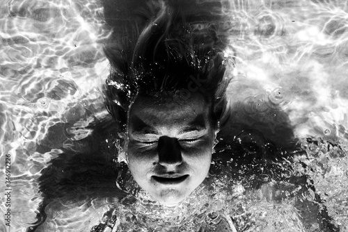 Fototapety, obrazy: Woman Swimming In A Swimming Pool